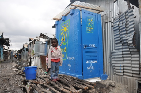 A young Fresh Life Toilet customer in Mukuru, Nairobi