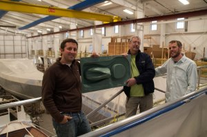Lyman-Morse Vice President Drew Lyman., Lyman-Morse Composites Guru Roy Lupien, and Sanergy's Mike Hahn showing off Sanergy's new squat plate thermoform mold in Lyman-Morse's new 'green' boatbuilding facility