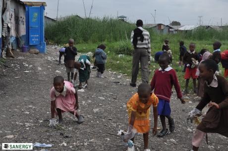 Students collecting trash in Mukuru, Nairobi.