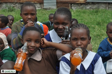 Bright Angels Academy student Lillian is in the middle, enjoying a Coca-Cola.