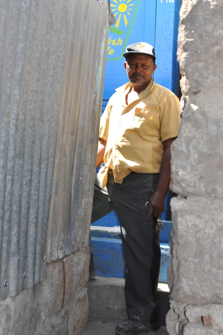 Ephantus, Fresh Life Operator and Landlord, standing in front of his former pit latrine, now a Fresh Life Toilet.
