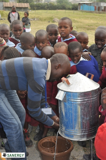 James instructing Baptist Primary students in proper handwashing techniques