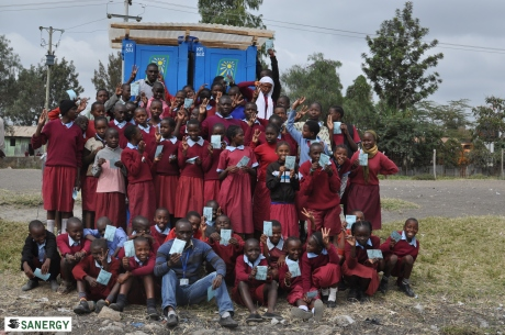 Baptist Primary students celebrating the opening of their Fresh Life Toilets with Peter and James