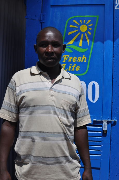 Fresh Life Operator David Mai in front of his Fresh Life Toilet