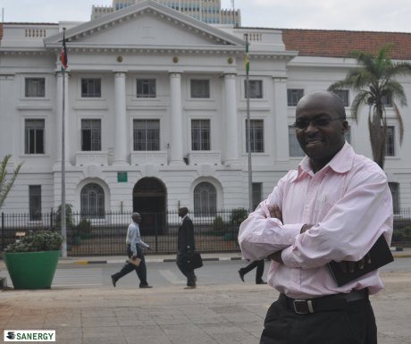 Alex in front of Nairobi City Hall.